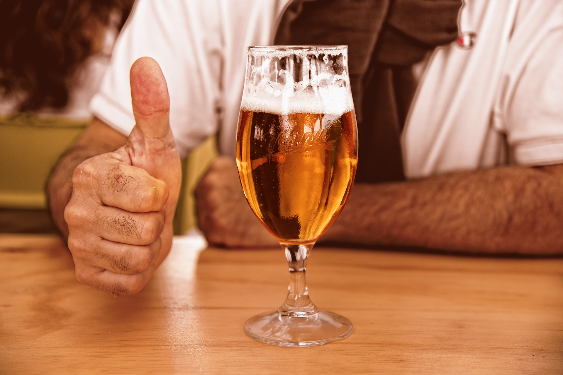 glass of beer with thumbs up